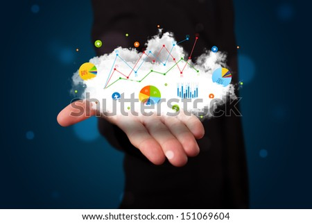 Young businessman presenting cloud with charts and graph icons and symbols - stock photo