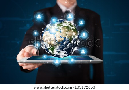 Young businessman presenting 3d earth globe in tablet elements of this image furnished by NASA - stock photo