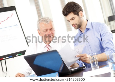 Young businessman presenting his idea to his colleagues at meeting. Teamwork. - stock photo