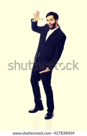 Young businessman presenting something in hands. - stock photo