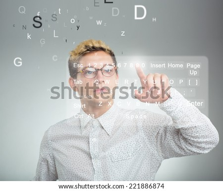 Young businessman pressing application button on computer with touch screen