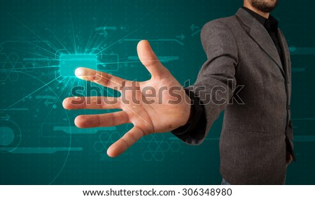Young businessman pressing high tech type of modern buttons - stock photo