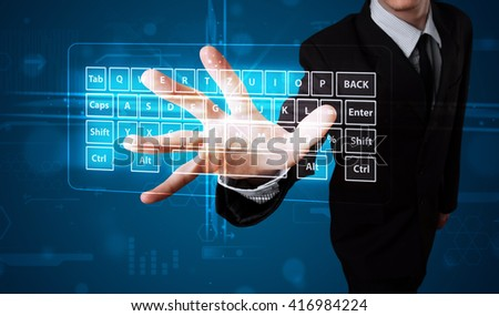 Young businessman pressing virtual type of keyboard - stock photo