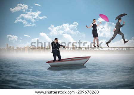 Young businessman pulling a tightrope for business people against white background with vignette - stock photo