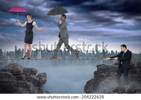 Young businessman pulling a tightrope for business people for business people against white background with vignette - stock photo