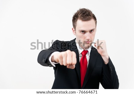 young businessman punching
