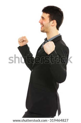 Young businessman punching the air isolated on white background. Side view.
