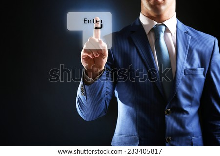 "Young businessman push ""Enter"" button"