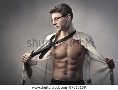 Young businessman putting off his skirt and tie