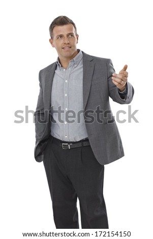 Young businessman raising hand, gesturing. - stock photo