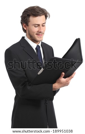 Young businessman reading a report isolated on a white background