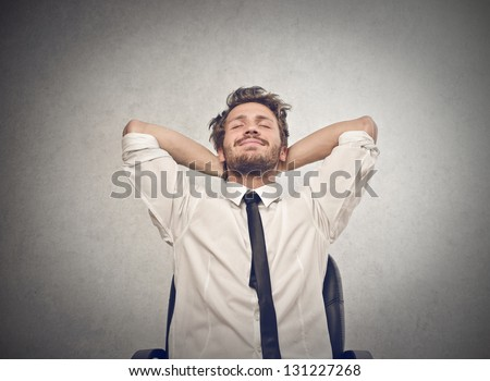 young businessman relaxes - stock photo