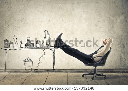 young businessman relaxes sitting in the office - stock photo