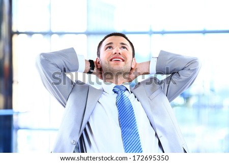 Young Businessman Relaxing On Chair in office