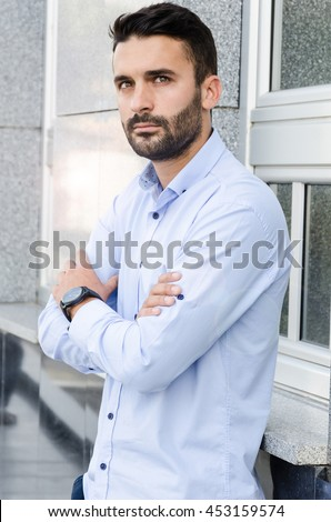 Young businessman resting on a break outside the building