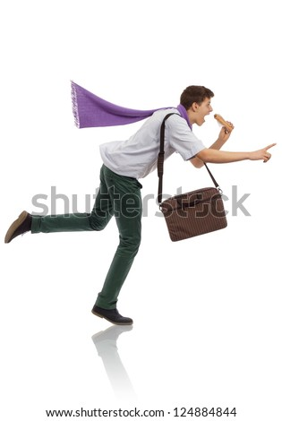 Young businessman running in a hurry - stock photo