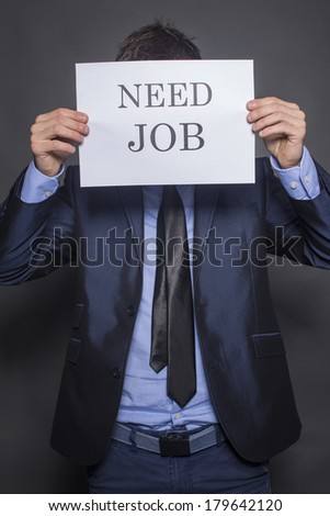 Young businessman searching for a job - stock photo
