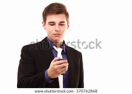 Young businessman seriously looking to the phone isolated on white