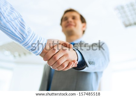 young businessman shaking hands with a colleague, an agreement - stock photo