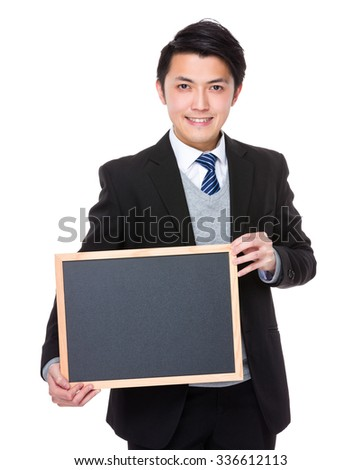 Young Businessman show with chalkboard