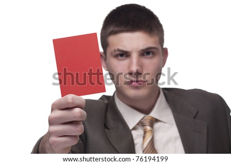 Young businessman showing a red card - stock photo