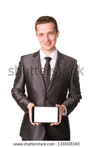 Young businessman showing a tablet pc comuter with blank screen for your sample text isolated on white - stock photo