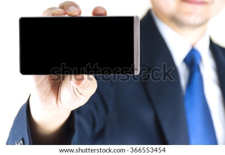 Young businessman showing black blank screen of mobile phone