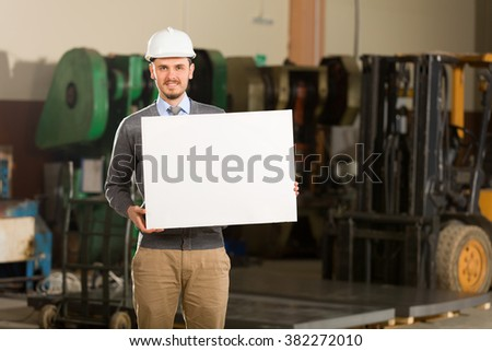 Young businessman showing placard. - stock photo