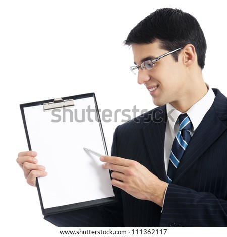 Young businessman showing signboard, isolated over white background