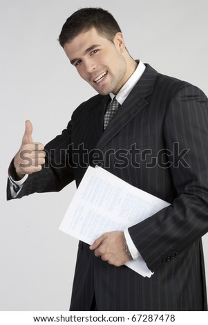 "Young businessman showing thumb up. Sign ""Yes"" - stock photo"