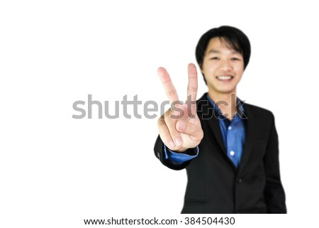 Young businessman showing two fingers with smiling face, with copy space, selective focus on hand, isolated on white background - stock photo