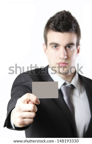 Young businessman shows an empty card