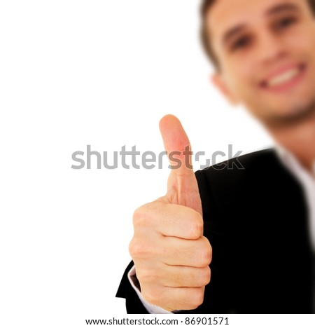 young businessman shows his hand with thumb up - stock photo