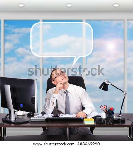 young businessman sitting in office and dreaming - stock photo