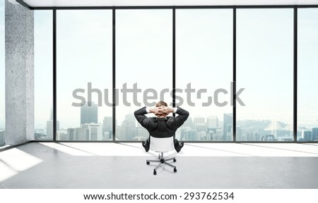 young businessman sitting in office and thinking - stock photo