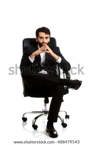 Young businessman sitting on a chair.
