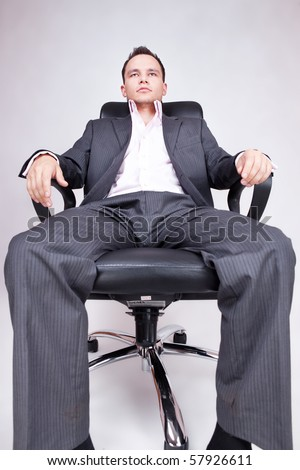 Young businessman sitting on chair