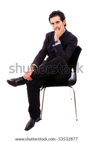 Young businessman sitting on chair, against white background - stock photo