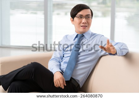 Young businessman sitting on sofa in the office
