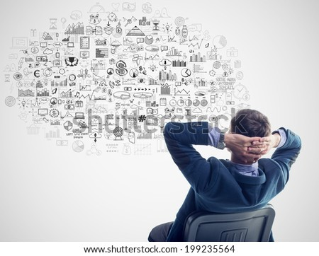 Young businessman sitting thinking dreaming about success profit development under thought bubble cloud business finance elements - stock photo