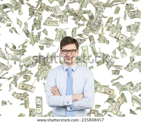 young businessman smiling and flying dollars