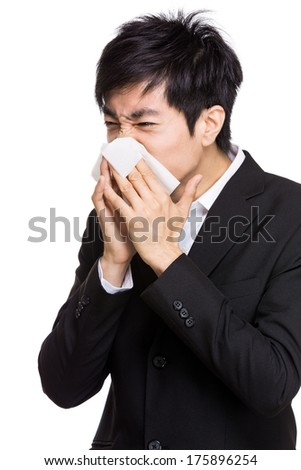 Young businessman sneeze - stock photo