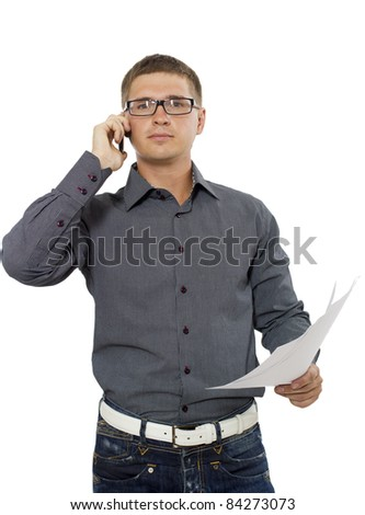 Young businessman speaking on the cellular phone - stock photo