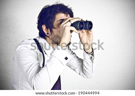 Young businessman spying  - stock photo