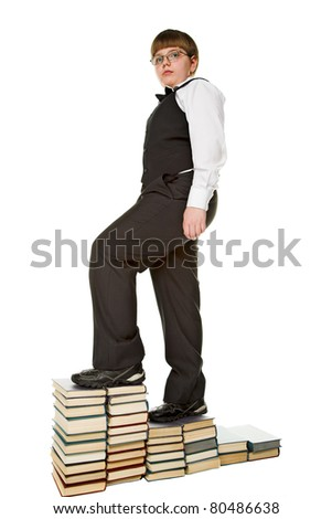 young  businessman stamding on the book podium