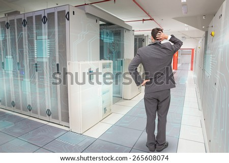 Technician Using Laptop While Analyzing Server Stock Photo
