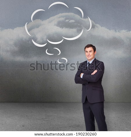 Young businessman standing cross-armed with speech bubble against clouds in a room - stock photo