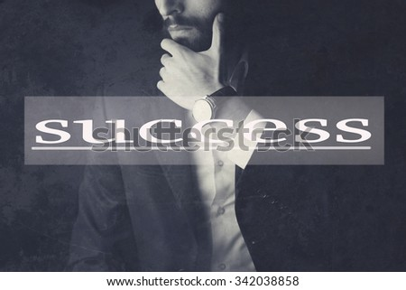 Young businessman standing hand on face - stock photo