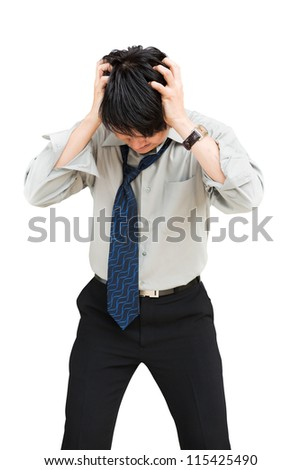 Young businessman standing head down as if sad or depressed, Isolated over white with clipping path - stock photo