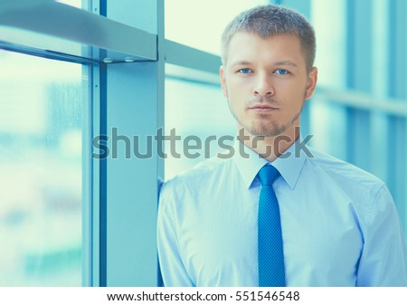 Young businessman standing in business center